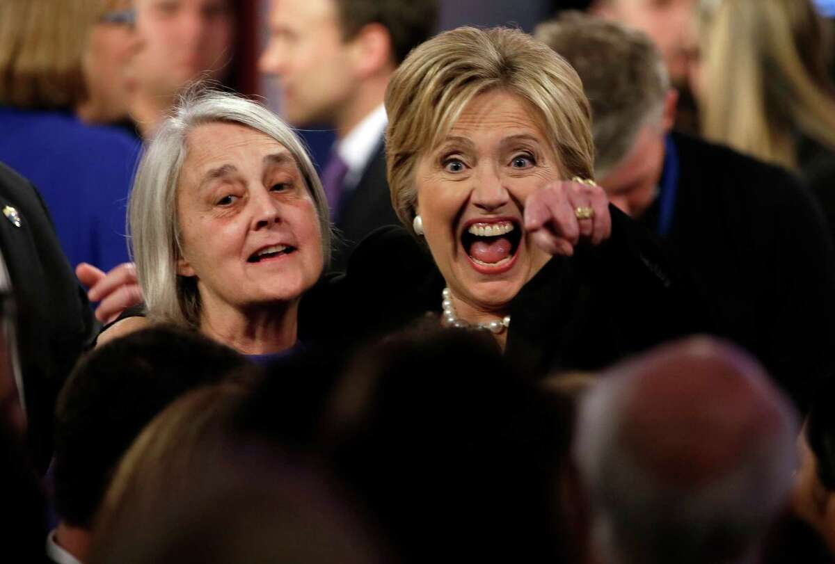 Hillary Rodham Clinton reacts as she talks to supporters after a Democratic presidential primary debate, Saturday, Nov. 14, 2015, in Des Moines, Iowa. (AP Photo/Charlie Neibergall) ORG XMIT: IAKS169