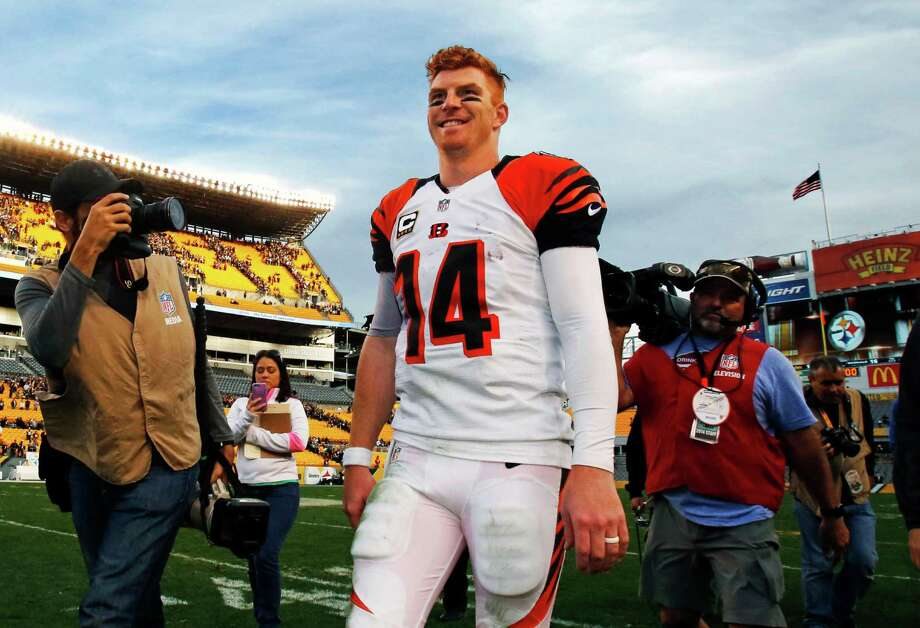 Cincinnati redhead Andy Dalton has made a habit of walking off the field a winner in 2015. The Bengals are 8-0 for the first time in team history, and a 111.0 passer rating has him on pace to shatter Carson Palmer's franchise record of 101.1. Photo: Gene J. Puskar, STF / AP
