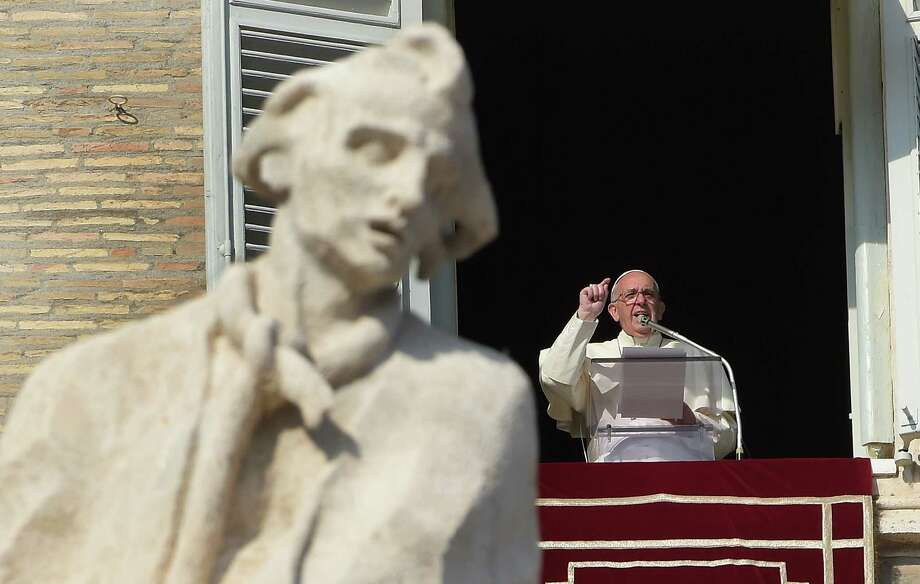Addressing the crowd in St. Peter's Square, Pope Francis  said   that using God's name to justify violence was sacrilege. The pope then invited the faithful to pray with him for the innocent victims of the attacks in Paris. Photo: Eric Vandeville / Tribune News Service / Abaca Press