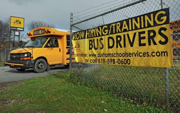 A Durham School Services bus is seen leaving the parking lot at the Durham School Services headquarters on South Pearl St. on Friday, Nov. 13, 2015 in Albany, N.Y.  (Lori Van Buren / Times Union) Photo: Lori Van Buren / 00034233A