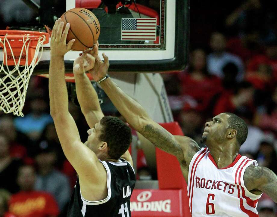 Terrence Jones (6) returned against the Nets on Wednesday after being out with an eye injury. Photo: Brett Coomer, Staff / © 2015 Houston Chronicle