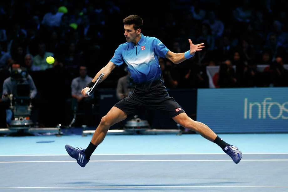 LONDON, ENGLAND - NOVEMBER 15:  Novak Djokovic of Serbia in action against Kei Nishikori of Japan during day one of the Barclays ATP World Tour Finals at O2 Arena on November 15, 2015 in London, England.  (Photo by Julian Finney/Getty Images) Photo: Julian Finney, Staff / 2015 Getty Images