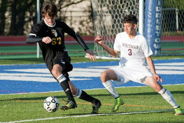 Ballston Spa's Connor Defillipis, left, and Walt Whitman's Michael Lorello compete for the ball in the State final boys' soccer game Sunday November 15, 2015, at Middletown High School in Middletown, N.Y. Photo by Karl Rabe for the Times Union