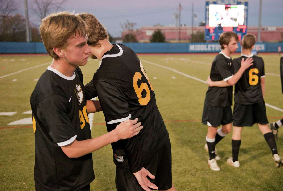 Ballston Spa's Meyer Aviles, left, and Thomas Preece react after loosing the State championship boys' soccer game against Walt Whitman Sunday November 15, 2015, at Middletown High School in Middletown, N.Y. Photo by Karl Rabe for the Times Union