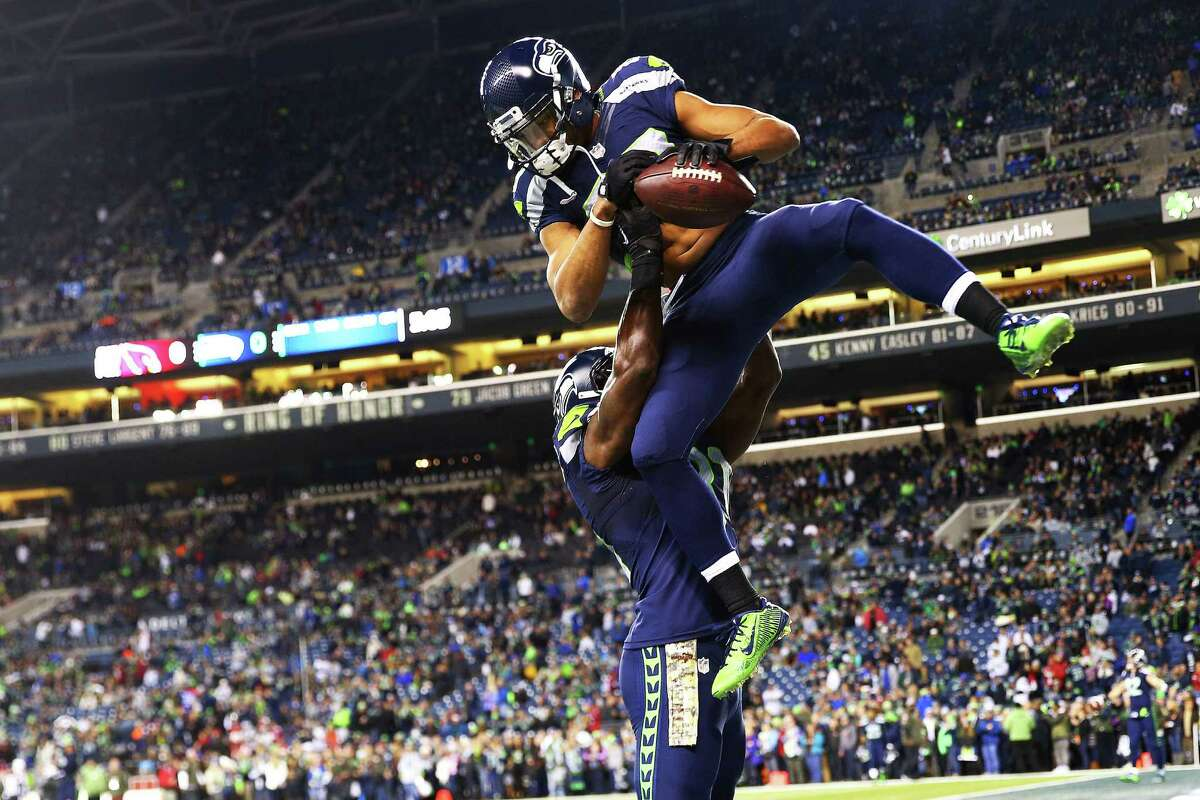 Seattle's Doug Baldwin (above) jumps into the arms of Kam Chancellor before the start of their game against the Cardinals, Sunday, Nov. 15, 2015 at CenturyLink Field.