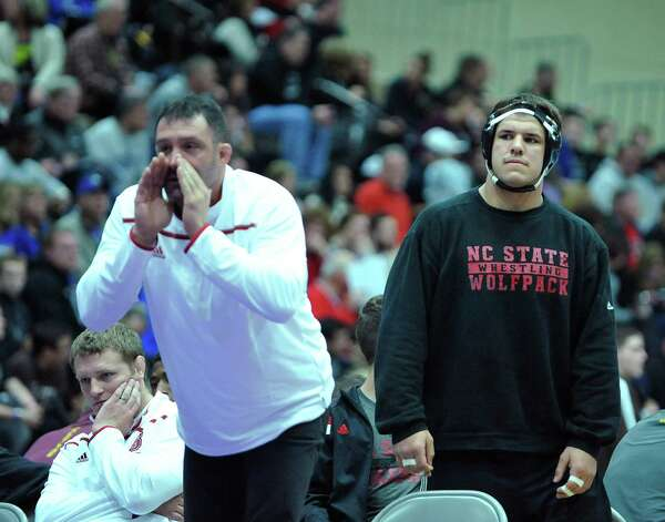 Nick Gwiazdowski, right, of NC State waits to compete at the Journeymen II Asics Northeast Duals on Sunday, Nov. 15, 2015, in Troy, N.Y.  Gwiazdowski is from Duanesburg.(Paul Buckowski / Times Union) Photo: PAUL BUCKOWSKI / 00034225A