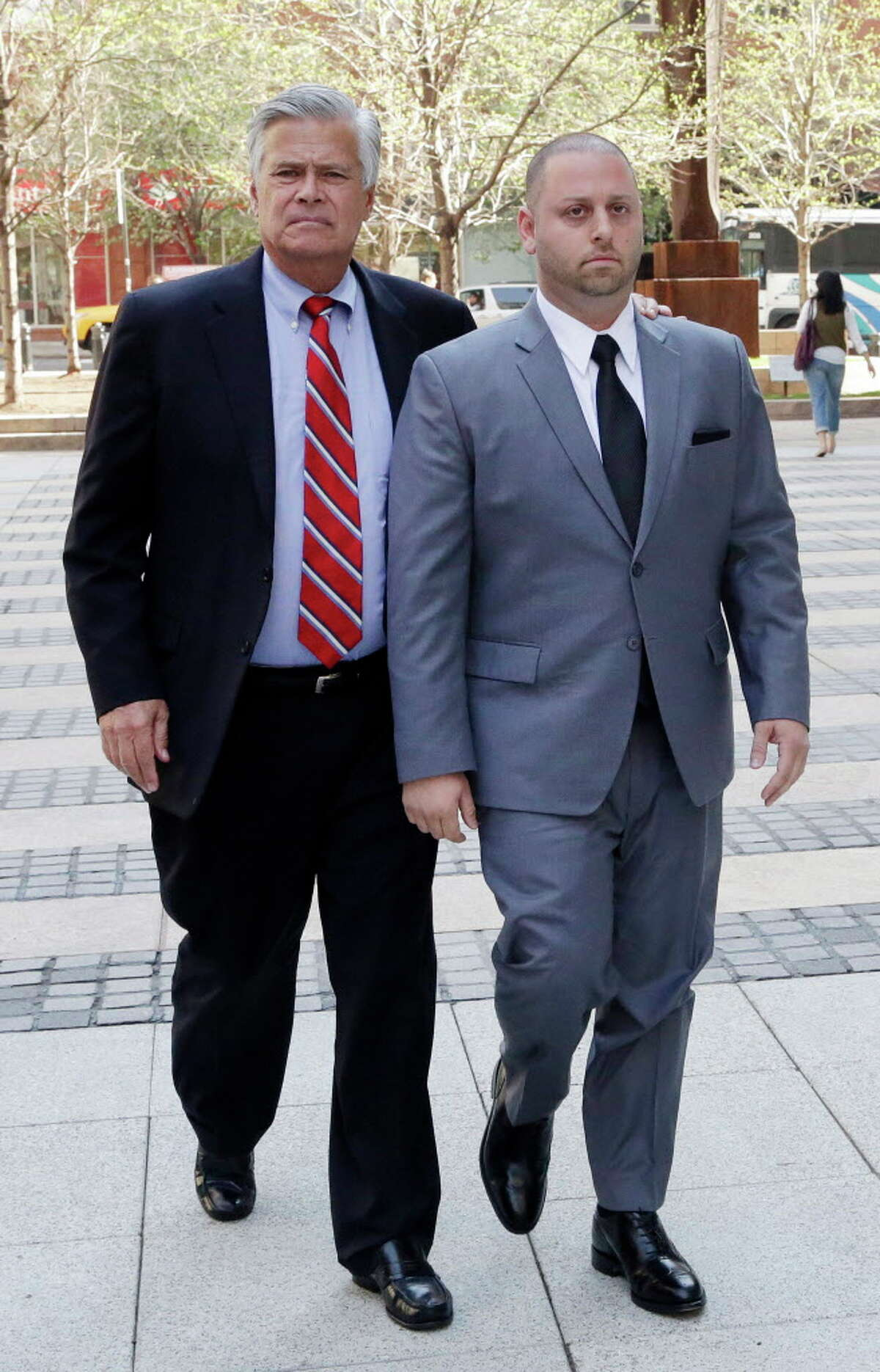 FILE- In this May 4, 2015, file photo New York Senate Majority Leader Dean Skelos, left, and his son Adam arrive at FBI offices in New York. Jury selection begins Monday, Nov. 16, in the Manhattan federal court in the extortion and bribery trial of Skelos and his son, Adam. (AP Photo/Mark Lennihan, File) ORG XMIT: NYR303