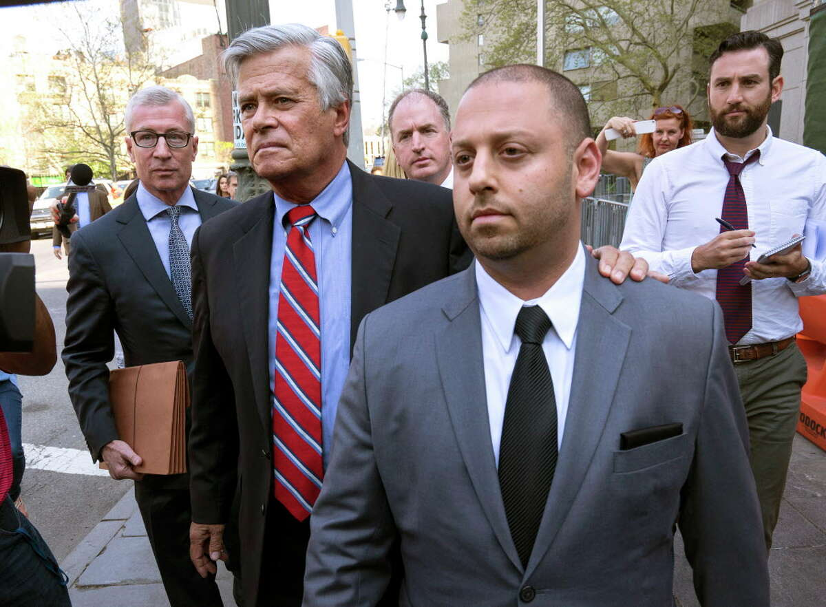 FILE- In this May 4, 2015, file photo New York Senate Majority Leader Dean Skelos, second from left, and his son Adam leave federal court in New York, after arraignment on charges. Jury selection begins Monday, Nov. 16, in the Manhattan federal court in the extortion and bribery trial of Skelos and his son, Adam. (AP Photo/Craig Ruttle, File) ORG XMIT: NYR302