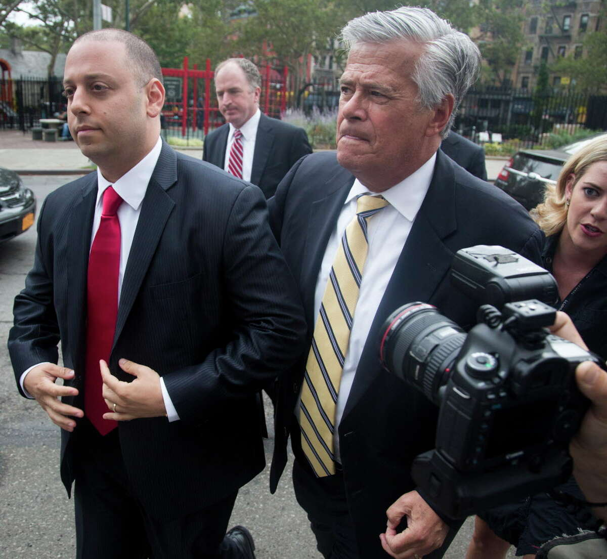 Former New York state Senate leader Dean Skelos, right, and his son Adam, 33, left, arrive for their arraignment in Manhattan federal court for the latest charges against them in a corruption case, Thursday, July 30, 2015, in New York. (AP Photo/Bebeto Matthews) ORG XMIT: NYBM101