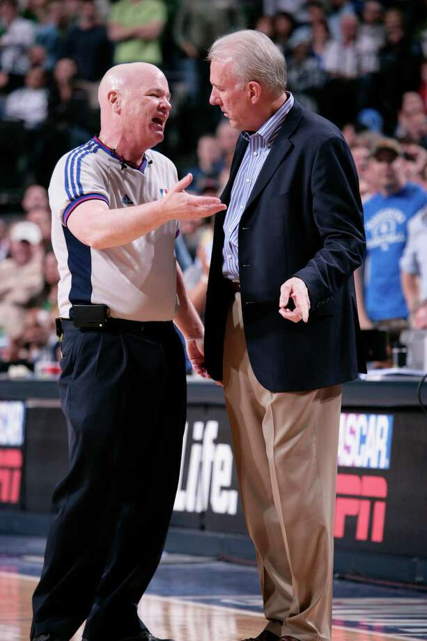 NBA official Joey Crawford explains to Spurs head coach Gregg Popovich why he gave Tim Duncan a second technical foul and ultimate ejection against the Mavericks on April 15, 2007, at the American Airlines Center in Dallas. Photo: Glenn James /Getty Images / 2007 NBAE