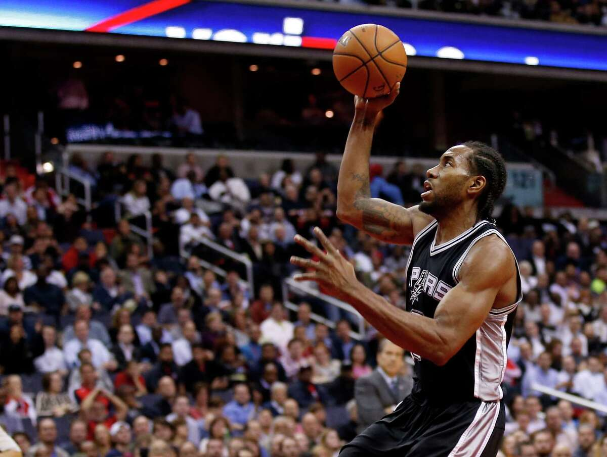 Spurs forward Kawhi Leonard goes up for a dunk in the first half against the Washington Wizardso on Nov. 4, 2015, in Washington.