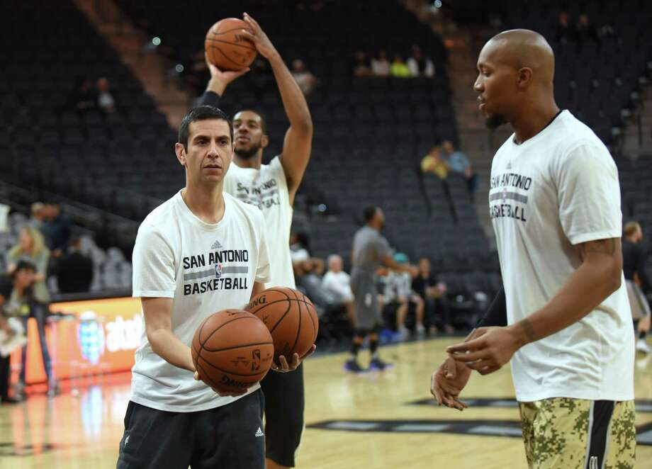 San Antonio Spurs assistant coach James Borrego retrieves balls for players as they shoot around before their game against the Charlotte Hornets in the AT&T Center on Saturday, Nov. 7. 2015. Photo: Billy Calzada, Staff / San Antonio Express-News / San Antonio Express-News