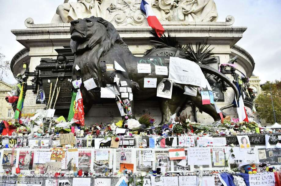 A makeshift memorial at the Place de la Republique in Paris honors the victims of the attacks that the Islamic State is claiming. The goal of ISIS is to inspire terror to get its way. The most effective response is to refuse to give in to fear. Photo: Loic Venance / AFP / Getty Images / AFP