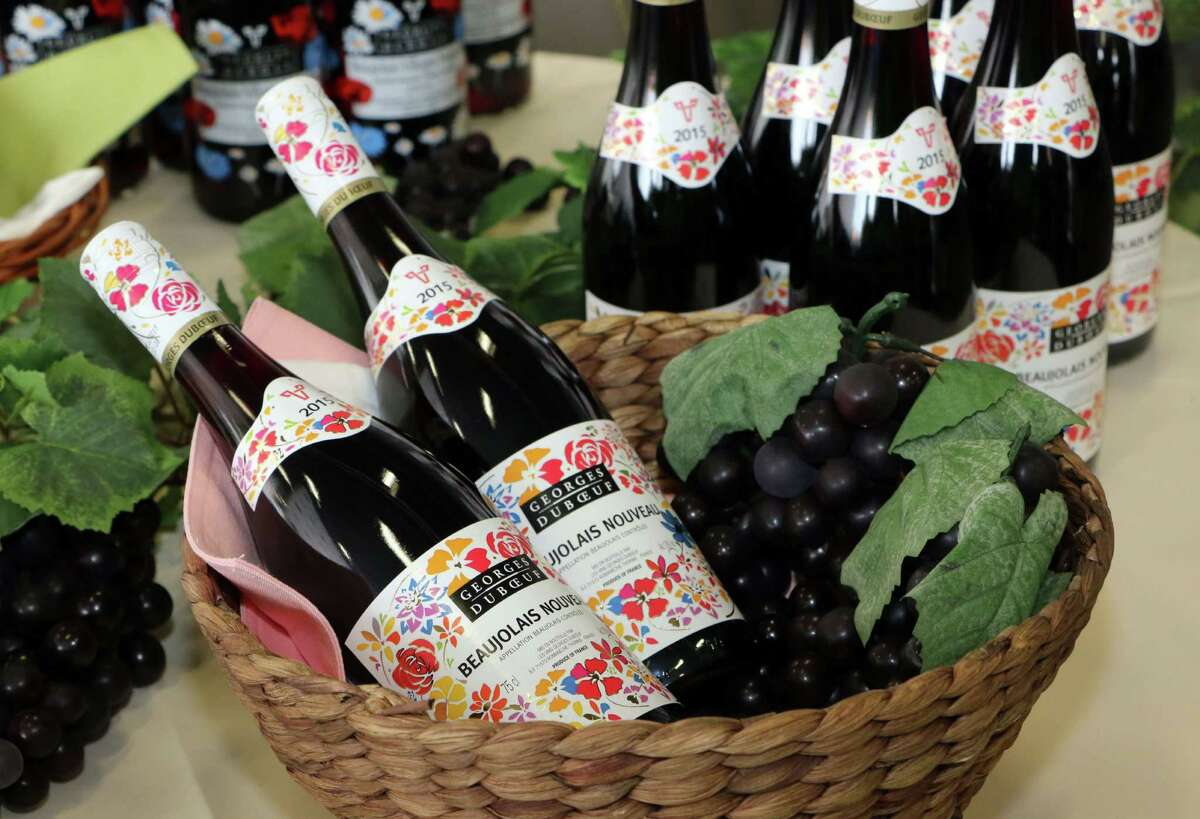 Bottles of 2015 Beaujolais Nouveau wine are displayed shortly after their arrival at Tokyo's Haneda Airport on October 31, 2015. The first cargo of 3,200 bottles arrived from Paris for November 19 when the embargo on the wine will be removed.
