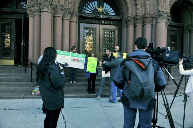 Albany Protected Bicycle Lane Coalition members take part in a protest outside city hall on Monday, Nov. 16, 2015, in Albany, N.Y.  The organizers of the event were calling for protected bicycle lanes on Madison Ave.  (Paul Buckowski / Times Union) Photo: PAUL BUCKOWSKI / 00034249A
