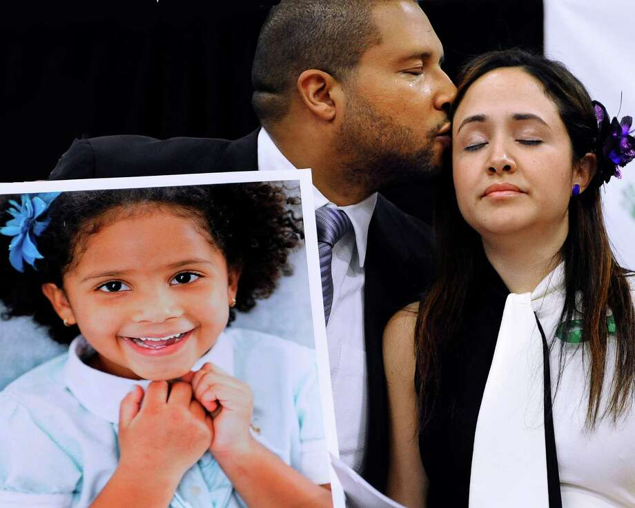Jimmy Greene, left, kisses his wife Nelba Marquez-Greene as he holds a portrait of their daughter, Sandy Hook School shooting victim Ana Marquez-Greene. File photo. Photo: Jessica Hill / Associated Press / FR125654 AP