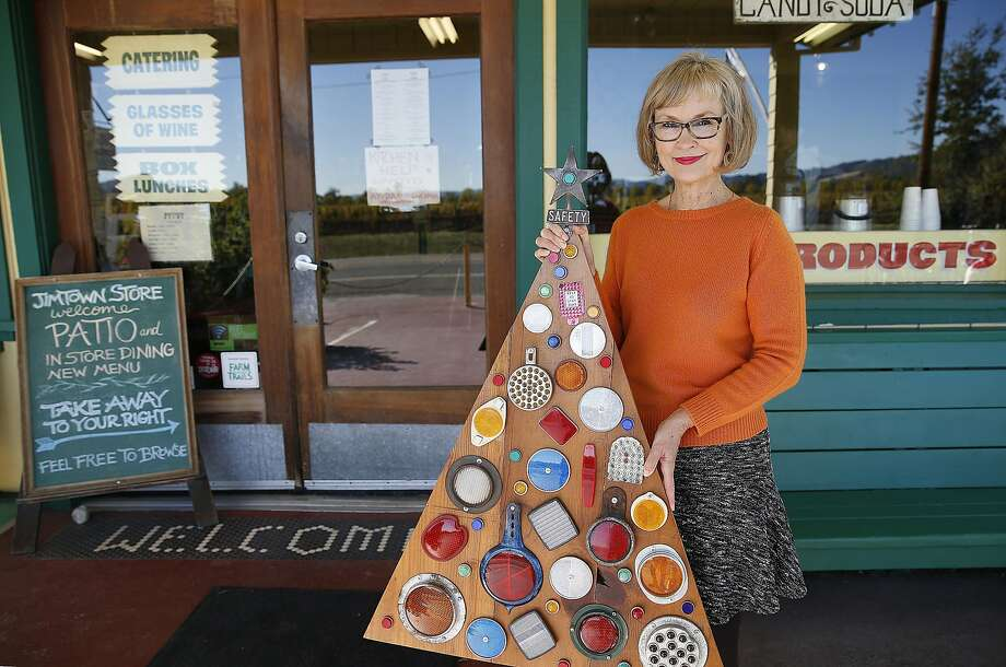 """Jimtown store and cafe owner Carrie Brown, author of """"The New Christmas Tree."""" Here, she shows her first tree outside the cafe in Healdsburg. Photo: Liz Hafalia, The Chronicle"""
