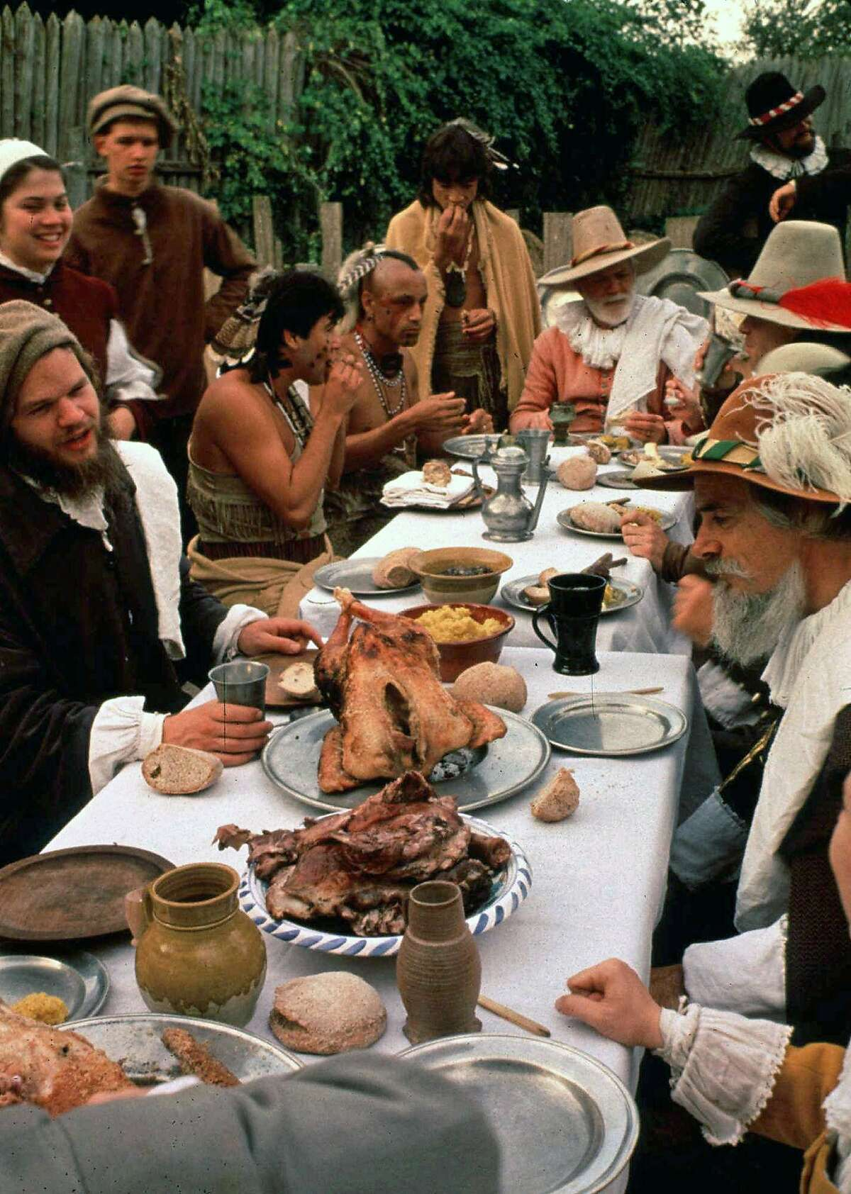** FOR IMMEDIATE RELEASE--FILE **This undated photo provided by Plimoth Plantation, shows a reenactment of the first Thanksgiving at the Plimoth Plantation in Plymouth, Mass. According to food writer Linda Beaulieu, the first Thanksgiving did not include Turkey or some of the other food items associated with the holiday. (AP Photo/Plimoth Plantation, Ted Curtin/FILE)