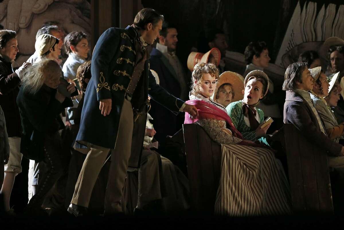 Brandon Jovanovich as Walther, Rachel Willis-Sorensen as Eva and Sasha Cooke as Magdalene during SF Opera dress rehearsal of Wagner's