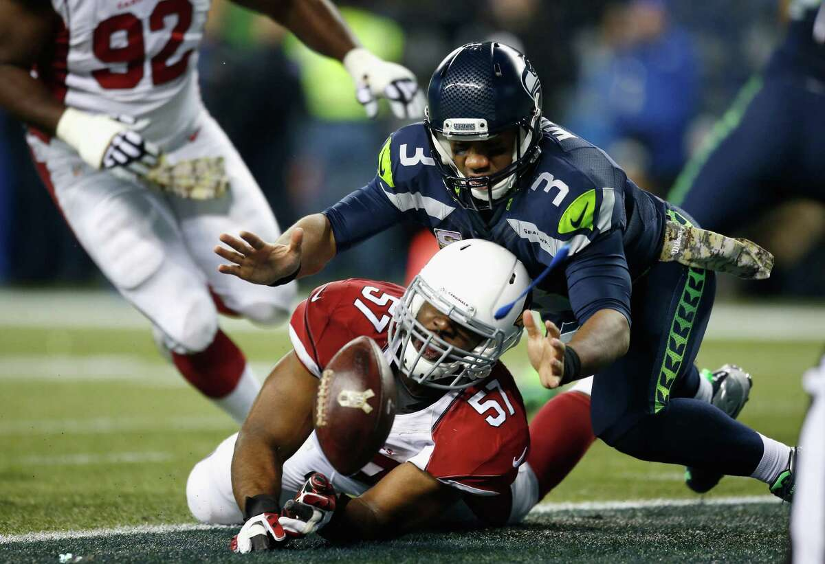 Quarterback: This is one of those games where the stats actually do tell the story, at least where Russell Wilson is concerned. Simply put, he was off all night while completing just 14 of 32 pass attempts. His second-quarter safety came after he was careless with the ball when scrambling from pressure and fumbled into his own end zone, while a third-quarter interception came on another bad throw. Grade: D+