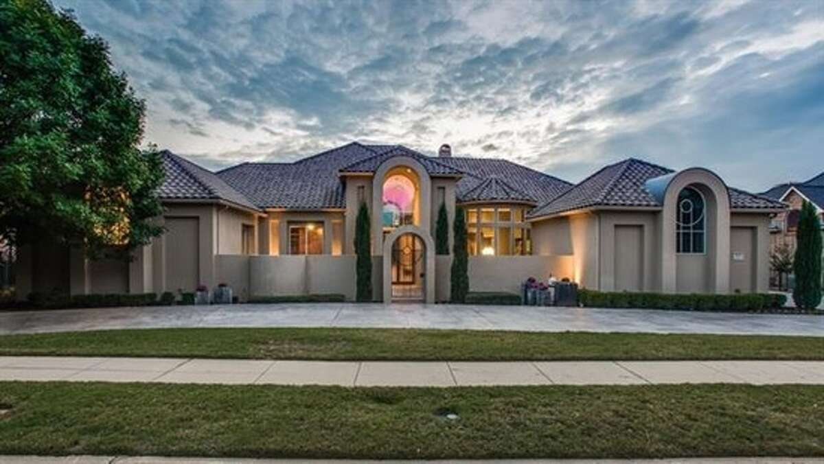 Former Dallas Cowboys player Gerald Sensabaugh is selling his sleek and prestigious home in Frisco, Texas for $1.82 million. The 7,528-square-foot home includes five bedrooms, six bathrooms, a home theater, a pool and outdoor kitchen.
