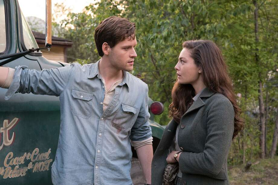 Luke Kleintank and Alexa Davalos as people from opposite coasts, both with copies of the Man in the High Castle's film. Photo: Amazon Studios
