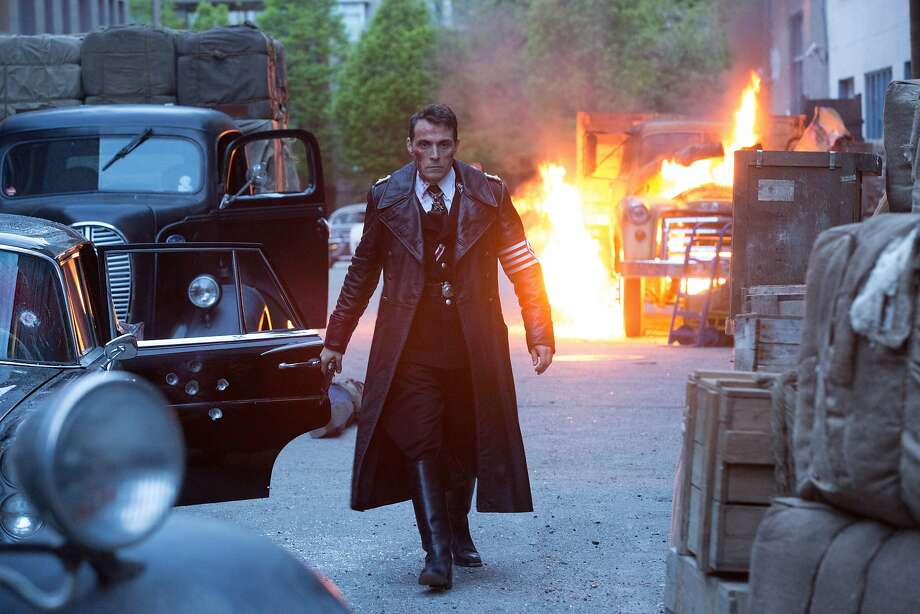 """Rufus Sewell as Obergruppen fuhrer John Smith keeps an eye on a copy of a subversive film in the Nazi part of a divided U.S. in """"The Man in the High Castle,"""" based on a Philip K. Dick novel. Photo: Amazon Studios"""