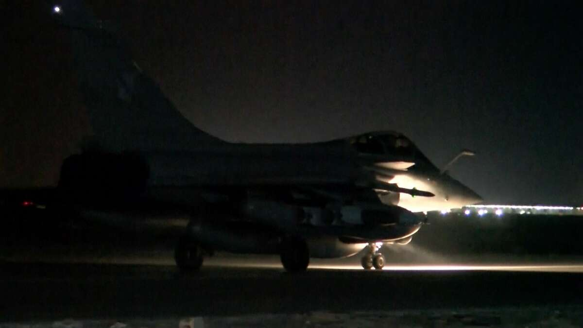 This image made from video released by the French Army Communications Audiovisual office (ECPAD) shows a French army jet taking off from a site in Jordan to strike at Islamic State group targets Sunday, Nov. 15, 2015. France launched