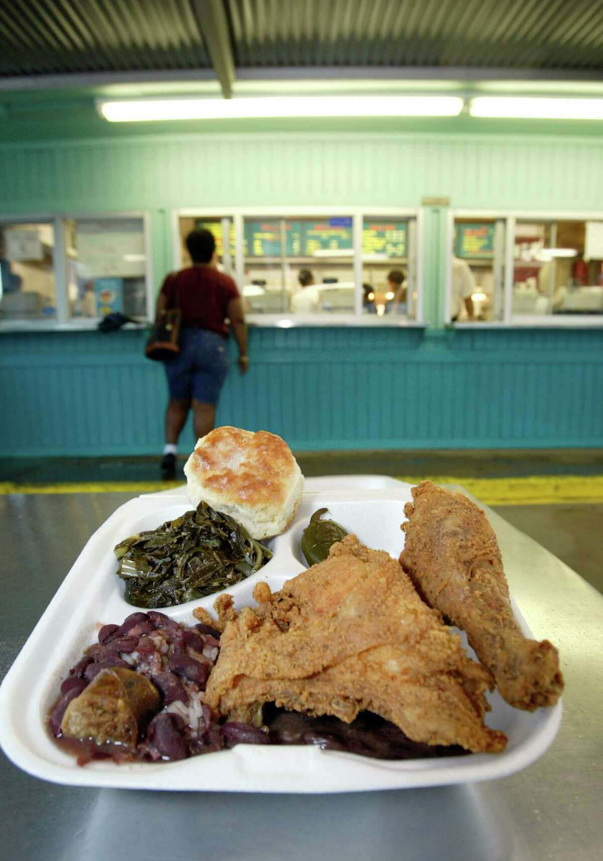 Fried chicken, greens, red beans and rice, biscuit served in the funky atmosphere of the covered patio.