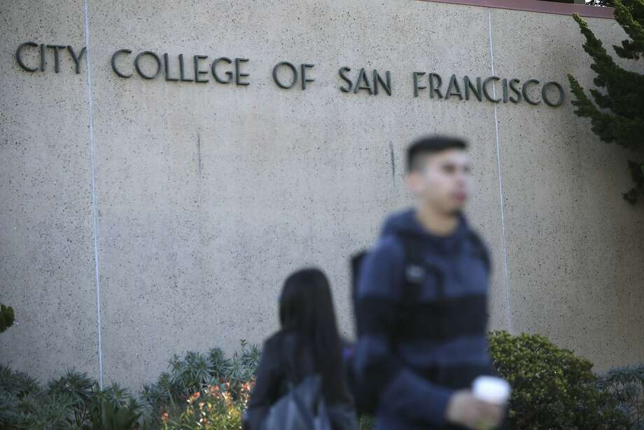 People walk past a sign for City College of San Francisco at the Ocean  Campus on Monday, November 16,  2015 in San Francisco, Calif. Photo: Lea Suzuki, The Chronicle