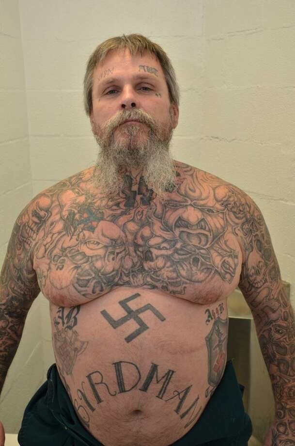 "Authorities call James Byrd a kingpin in the Aryan Brotherhood of Texas. Prosecutors described the gang-related markings on his body: ""He has three ABT ""patches,"" one on each side of his abdomen and one on his calf, multiple swastikas, and additional Nazi symbols. Some of the more prominent links to white supremacy were David Lane's ""14 words""1 written out on his side, a poem about the Brotherhood on the other side, the Roman numerals I and II (standing for A [Aryan] and B [Brotherhood], the first and second letters of the alphabet) on his eyelids, and a roughly 20-inch depiction of Adolf Hitler on his back."" He also had ""a scalp covered in tattoos: a scorpion going up the back of his neck with its claws pointing to ""1488"" (the ""14 spoken words"" by David Lane and ""88"" for ""Heil Hitler""—H being the eighth letter of the alphabet) and the stinger going around his neck and up his chin."""