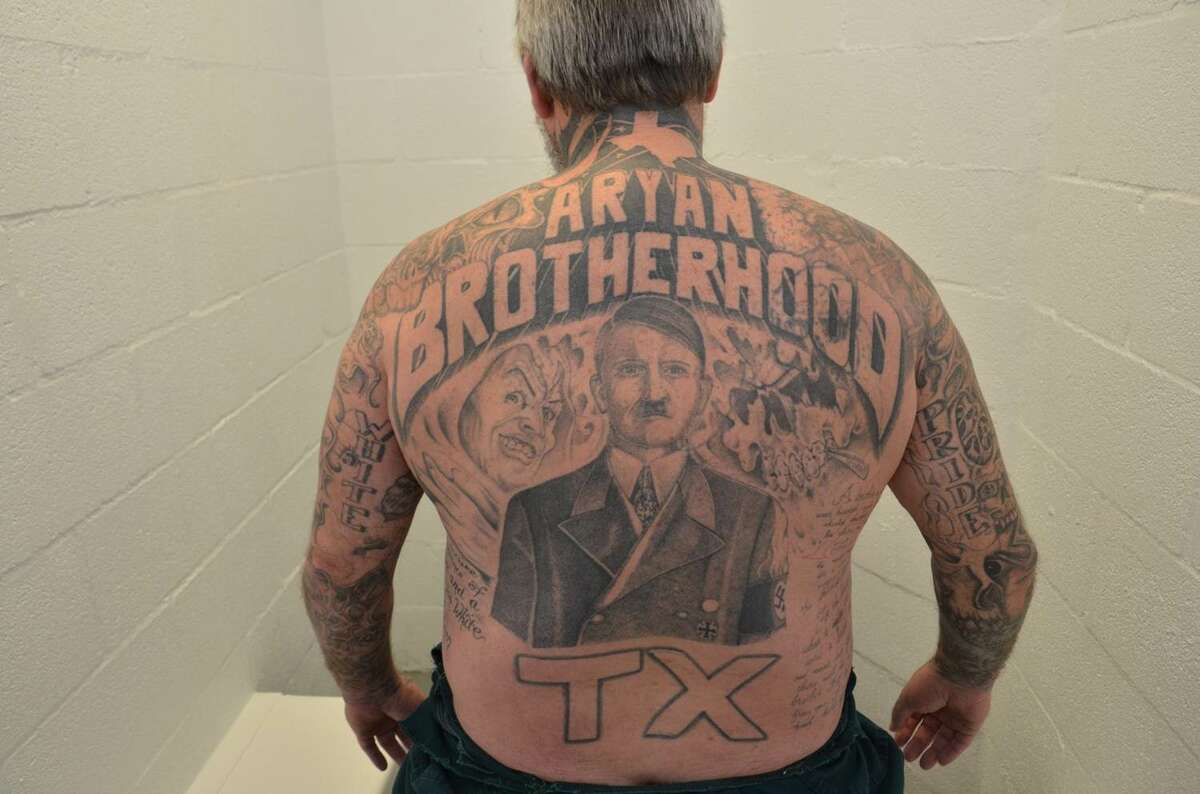 """Authorities call James Byrd a kingpin in the Aryan Brotherhood of Texas.Prosecutors describedthe gang-related markings on his body: """"He has three ABT """"patches,"""" one on each side of his abdomen and one on his calf, multiple swastikas, and additional Nazi symbols. Some of the more prominent links to white supremacy were David Lane's """"14 words""""1 written out on his side, a poem about the Brotherhood on the other side, the Roman numerals I and II (standing for A [Aryan] and B [Brotherhood], the first and second letters of the alphabet) on his eyelids, and a roughly 20-inch depiction of Adolf Hitler on his back."""" He also had """"a scalp covered in tattoos: a scorpion going up the back of his neck with its claws pointing to """"1488"""" (the """"14 spoken words"""" by David Lane and """"88"""" for """"Heil Hitler""""-H being the eighth letter of the alphabet) and the stinger going around his neck and up his chin."""""""