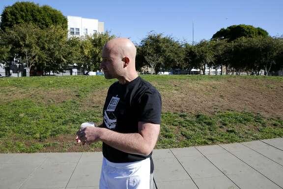 Adam Mesnick stands in a park near his restaurant Deli Board in San Francisco, California, on Monday, Nov. 16, 2015.