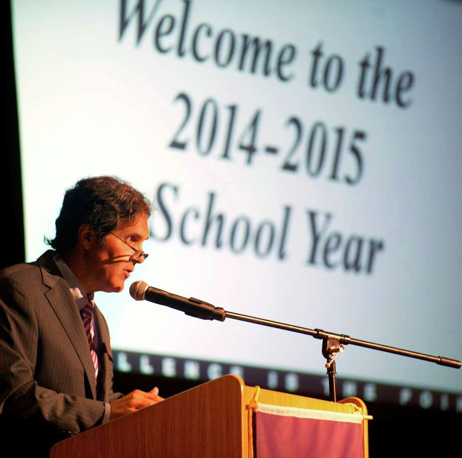 Stamford Education Association President Mike Arcano speaks during the annual convocation to start the new school year at Westhill High School on Wednesday, August 27, 2014. Photo: Lindsay Perry / Lindsay Perry / Stamford Advocate