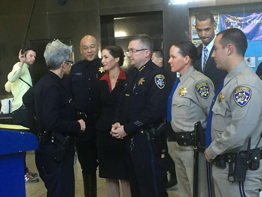 Oakland Police Chief Sean Whent speaks with Officer johnna Watson and Mayor Libby Schaaf ahead of a press conference on Nov, 16, 2015, to address a man who was fatally shot by police amidst massive sideshows in Oakland over the weekend.~~ Photo: Kale Williams