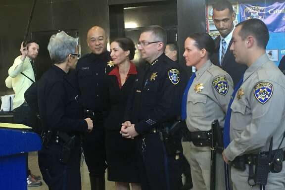Oakland Police Chief Sean Whent speaks with Officer johnna Watson and Mayor Libby Schaaf ahead of a press conference on Nov, 16, 2015, to address a man who was fatally shot by police amidst massive sideshows in Oakland over the weekend.~~