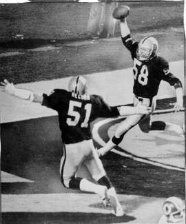Jack Squirek intercepts a screen pass and runs it in for a touchdown in Super Bowl XVIII. vs the Washington Redskins January 23, 1984