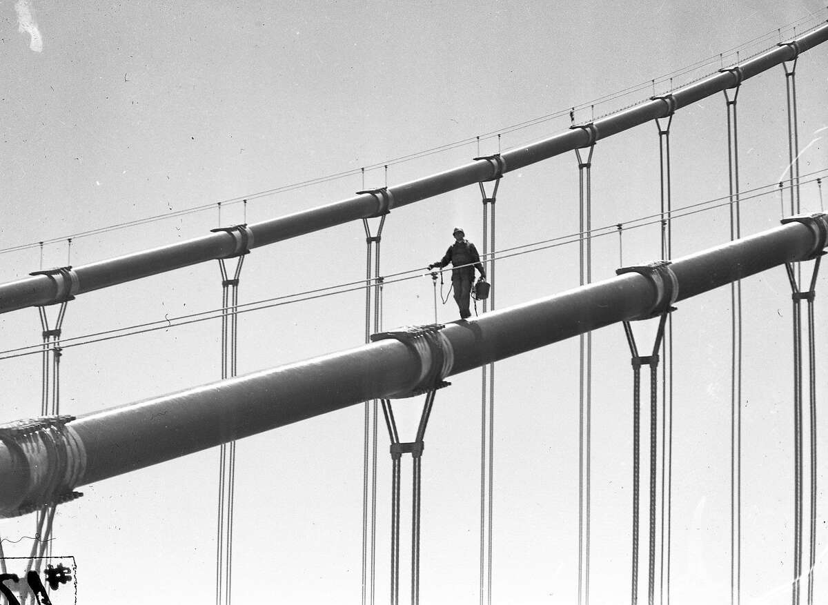 These workers are painting the South Tower of the Golden Gate Bridge, June 1950
