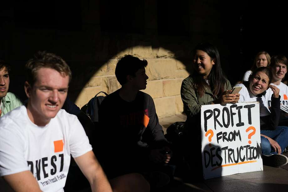 Students host a sit in in front of the president's office at Stanford University in Palo Alto, Calif. on Monday, Nov. 16, 2015. Students demanded that the university divest from its financial ties to fossil fuels. Photo: James Tensuan, Special To The Chronicle