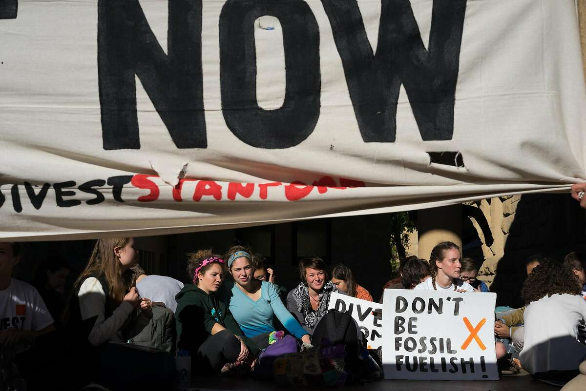 Students host a sit in in front of the president's office at Stanford University in Palo Alto, Calif. on Monday, Nov. 16, 2015. Students demanded that the university divest from its financial ties to fossil fuels.