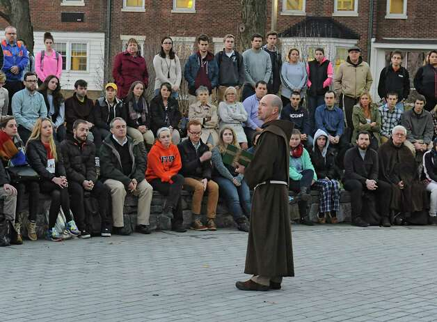 Siena College Chaplain the Rev. Lawrence Anderson says a prayer during a vigil at the campus grotto on Monday, Nov. 16, 2015 in Loundonville, N.Y., for the victims of the Paris attacks on Friday. (Lori Van Buren / Times Union) Photo: Lori Van Buren / 00034287A