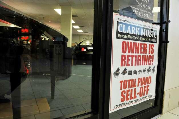 A sign on the front door is seen at Clark Music on Monday, November 16, 2015, in Clifton Park, N.Y.  Clark Music is closing.   (Paul Buckowski / Times Union) Photo: PAUL BUCKOWSKI / 00034253A
