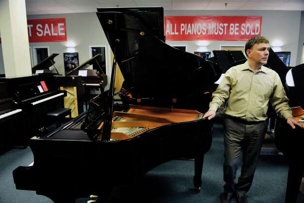 Tony Falcetti, president of Falcetti Music, talks about pianos and the piano business during an interview at Clark Music on Monday, November 16, 2015, in Clifton Park, N.Y.  Clark Music is closing and  Falcetti is overseeing the piano sale at Clark Music for Yamaha Corporation of America.  (Paul Buckowski / Times Union) Photo: PAUL BUCKOWSKI / 00034253A