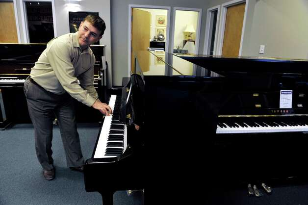 Tony Falcetti, president of Falcetti Music, plays one of the pianos during an interview at Clark Music on Monday, November 16, 2015, in Clifton Park, N.Y.  Clark Music is closing and  Falcetti is overseeing the piano sale at Clark Music for Yamaha Corporation of America.  (Paul Buckowski / Times Union) Photo: PAUL BUCKOWSKI / 00034253A