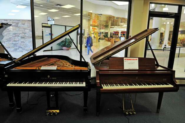 A view looking out onto the mall from inside the Clark Music store on Monday, November 16, 2015, in Clifton Park, N.Y.  Clark Music is closing.   (Paul Buckowski / Times Union) Photo: PAUL BUCKOWSKI / 00034253A