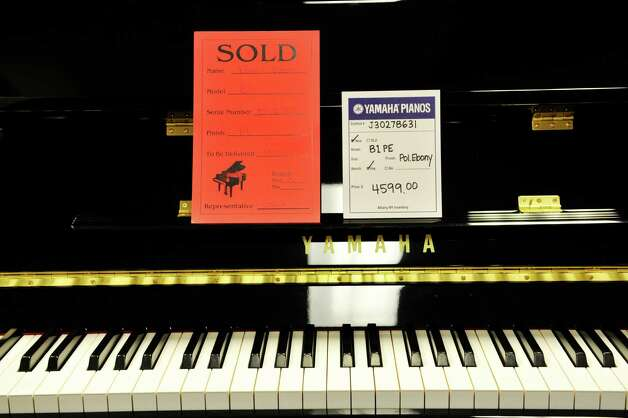 A view of one of the pianos that have sold at Clark Music on Monday, November 16, 2015, in Clifton Park, N.Y.  Clark Music is closing.   (Paul Buckowski / Times Union) Photo: PAUL BUCKOWSKI / 00034253A