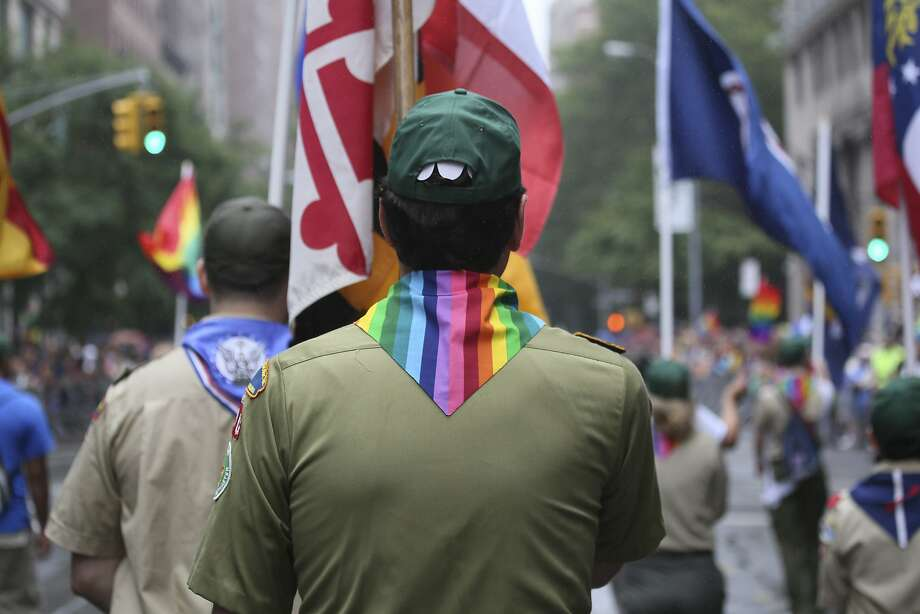 FILE -- Boy Scouts participate in New York City's annual gay pride parade, June 28, 2015. The Boy Scouts of America has ended its blanket ban on gay leaders, but the policy allows church-run units to pick leaders who agree with their moral precepts. (James Estrin/The New York Times) Photo: James Estrin, New York Times