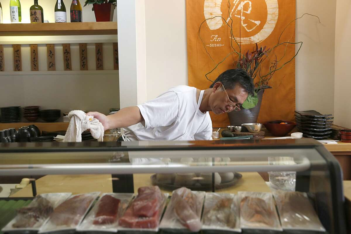 Owner-chef Kiyoshi Hayakawa cleans and preps the restaurant before opening An Japanese restaurant for dinner in San Francisco, California, on Friday, November 13, 2015.
