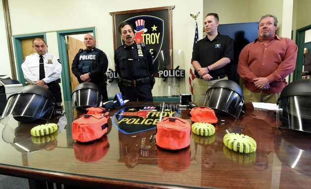 Troy Police Department unveiled new riot and safety gear during a press conference at their headquarters Monday morning Nov. 16, 2015, in Troy, N.Y. Attending the presentation of the equipment are, from left; Troy Chief John Tedesco, Officer Dominick Comitale, Sgt. Sam Carello and Ryan T. Smith, executive director of Spirit of Blue. The gear was derived from a grant from the Spirit of Blue program with the help of the Dunkin' Donuts Corporation (Skip Dickstein/Times Union) Photo: SKIP DICKSTEIN / 00034257A