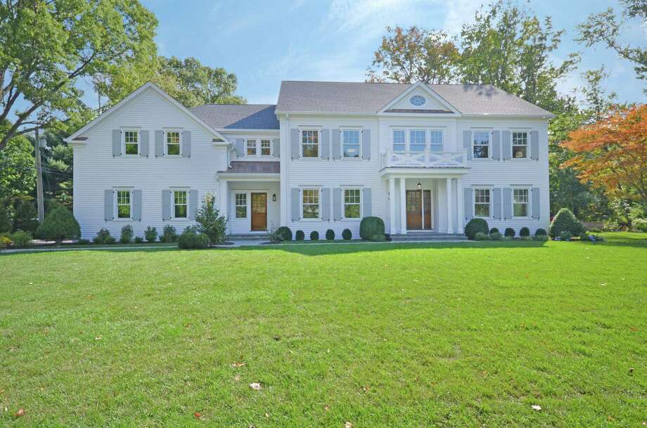 This white clapboard-sided home is at Tulip Tree Lane and Raymond Street in Darien. Photo: Contributed / Contributed Photo / Darien News